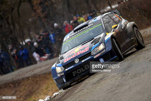 Andreas Mikkelsen of Norway and Ola Floene of Norway compete in their Volkswagen Motorsport II Polo R WRC during Day Two of the WRC Montecarlo on...