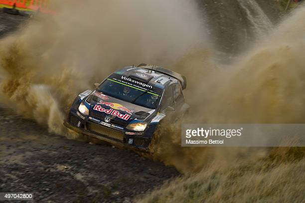 Andreas Mikkelsen of Norway and Ola Floene of Norway compete in their Volkswagen Motorsport II Volkswagen Polo R WRC during Day One of the WRC Wales...