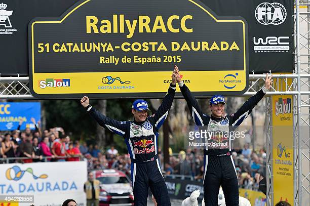 Andreas Mikkelsend of Norway and Ola Floene of Norway celebrate their success during Day Three of the WRC Spain on October 25 2015 in Salou Spain