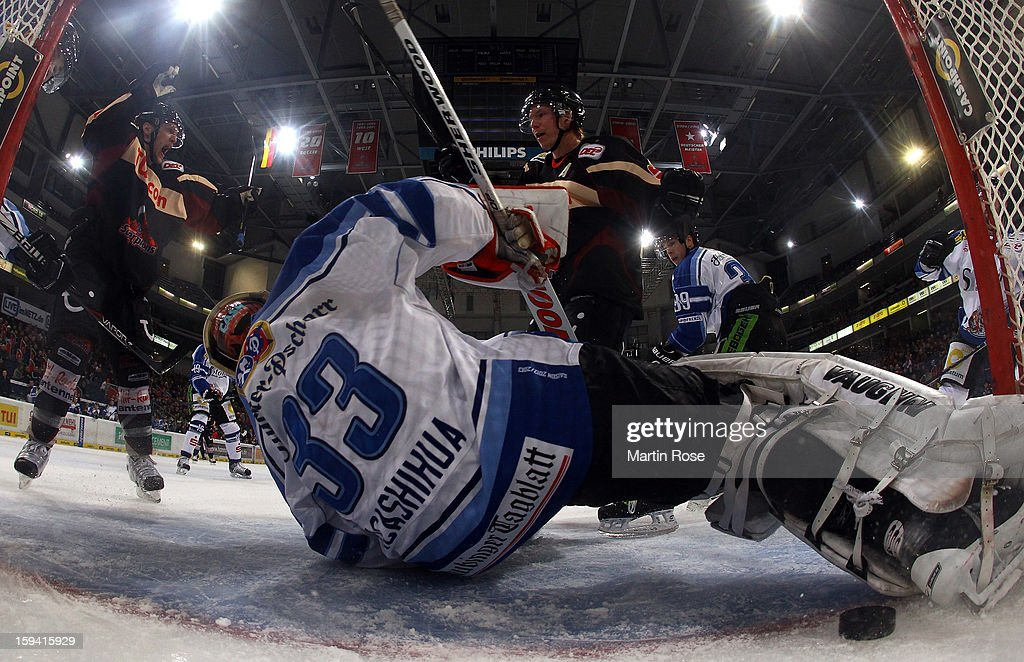 Andreas Morczinietz of Hannover celebrate with team mate Morten Green his team's 4th goal over Jason Bacashihua goaltender of Straubing during the...