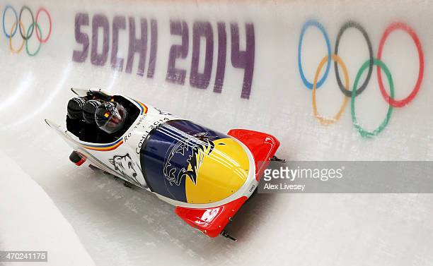 Andreas Neagu of Romania pilots a run during a fourman bobsleigh practice session on Day 12 of the Sochi 2014 Winter Olympics at Sliding Center Sanki...