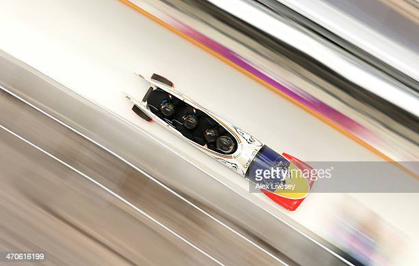 Andreas Neagu of Romania pilots a run during a fourman bobsleigh practice session on Day 13 of the Sochi 2014 Winter Olympics at Sliding Center Sanki...
