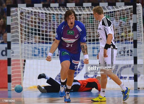 Andreas Nilsson of Hamburg celebrates during the DKB Handball Budesliga mtach between HSV Hamburg and THW Kiel at the O2 world on September 7 2013 in...