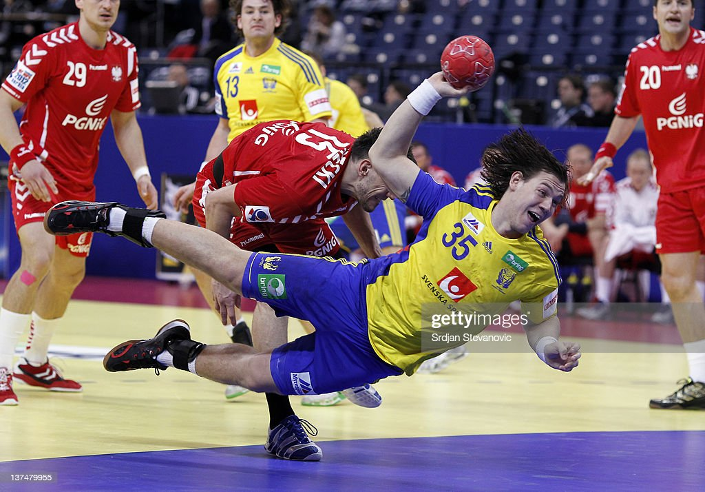 Andreas Nilsson (C) of Sweden scores during the Men's European Handball Championship 2012 main group 1 match between Poland and Sweden, at Belgrade Arena Hall on January 21, 2011 in Belgrade, Serbia.
