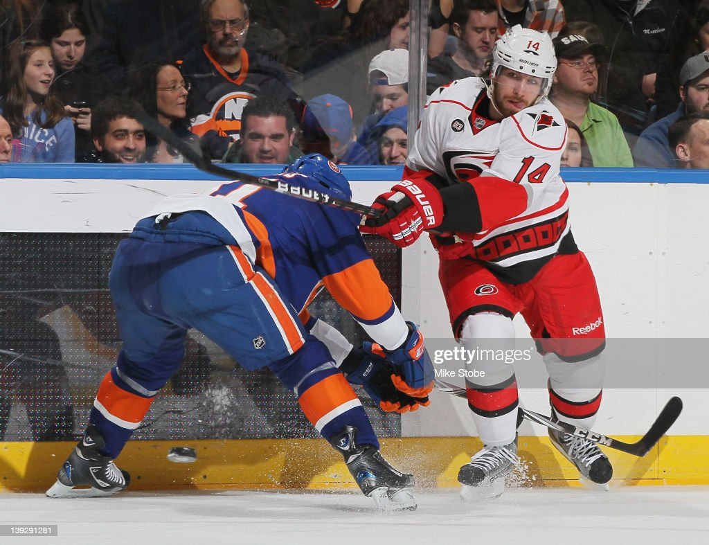 Andreas Nodl #14 of the Carolina Hurricanes fires the puck past <a gi-track='captionPersonalityLinkClicked' href=/galleries/search?phrase=John+Tavares&family=editorial&specificpeople=601791 ng-click='$event.stopPropagation()'>John Tavares</a> #91 of the New York Islanders at Nassau Veterans Memorial Coliseum on February 18, 2012 in Uniondale, New York. The Islanders defeated the Hurricanes 4-3.