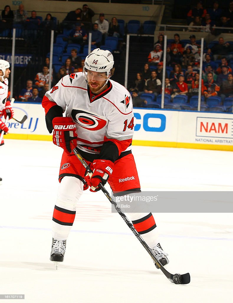 Andreas Nodl #14 of the Carolina Hurricanes in action against the New York Islanders during their game at Nassau Veterans Memorial Coliseum on February 11, 2013 in Uniondale, New York.