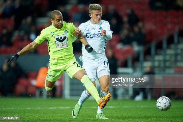 Andreas Nordvik of Esbjerg fB and Andreas Cornelius of FC Copenhagen compete for the ball during the Danish Alka Superliga match between FC...