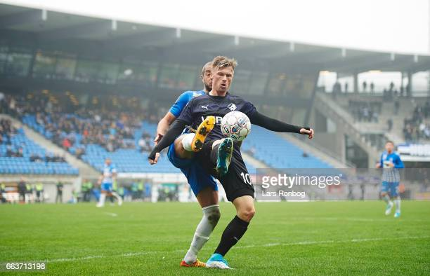 Andreas Nordvik of Esbjerg fB and Marvin Pourie of Randers FC compete for the ball during the Danish Alka Superliga match between Esbjerg fB and...