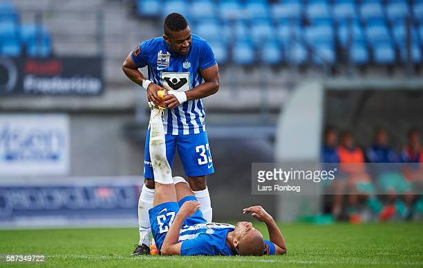 Andreas Nordvik of Esbjerg fB receives help from teammate Kevin Mensah of Esbjerg fB during the Danish Alka Superliga match between Esbjerg fB and...