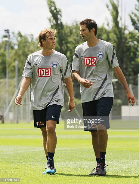 Andreas Ottl talks to Andre Mijatovic during the first Hertha BSC Berlin team training session at 'Schenckendorfplatz' on June 25 2011 in Berlin...