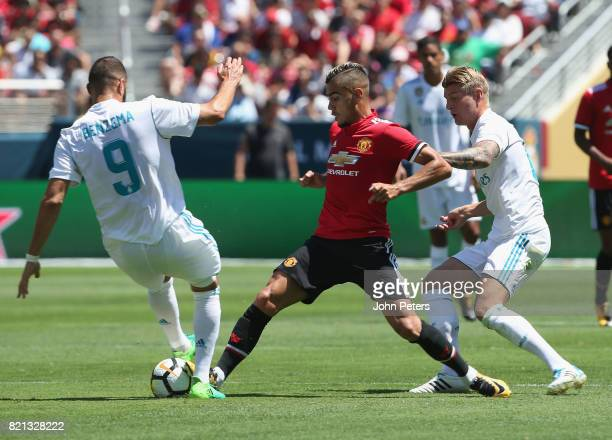 Andreas Pereira of Manchester United in action with Karim Benzema of Real Madrid during the International Champions Cup 2017 preseason friendly match...