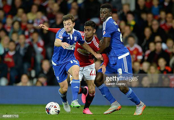 Andreas Pereira of Manchester United is tackled by Tommy Oar and Luke Hyam of Ipswich Town during the Capital One Cup Third Round match between...