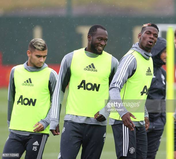 Andreas Pereira Romelu Lukaku and Paul Pogba of Manchester United in action during a first team training session at Aon Training Complex on August 1...
