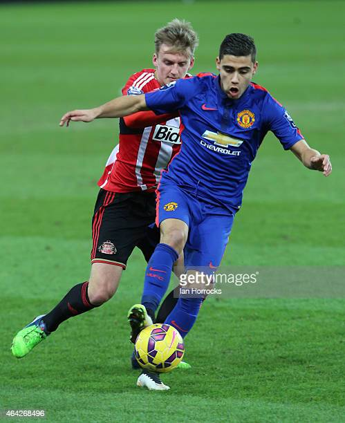 Andreas Pereria of Manchester United holds off Martin Smith of Sunderland during the Barclays Under 21 League match between Sunderland and Manchester...
