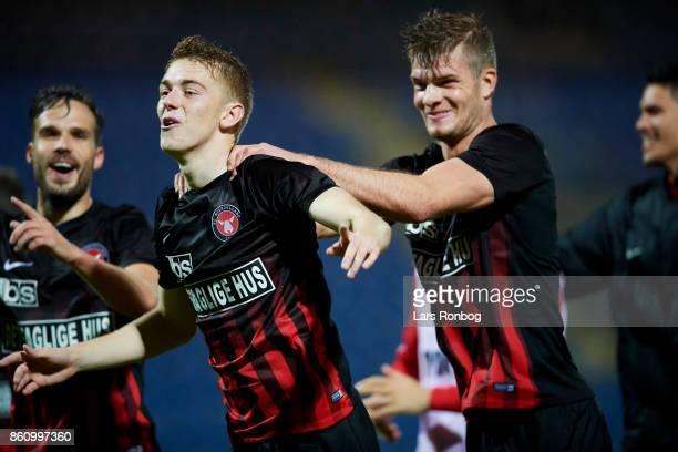 Andreas Poulsen and Alexander Sorloth of FC Midtjylland celebrate after the Danish Alka Superliga match between Sonderjyske and FC Midtjylland at...