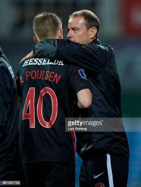 Andreas Poulsen of FC Midtjylland and Jess Thorup head coach of FC Midtjylland huddle during the Danish Alka Superliga match between Sonderjyske and...