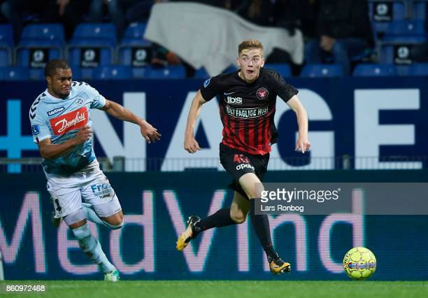 Andreas Poulsen of FC Midtjylland and Ramon Rodrigues of Sonderjyske compete for the ball during the Danish Alka Superliga match between Sonderjyske...