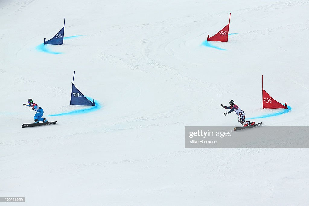 <a gi-track='captionPersonalityLinkClicked' href=/galleries/search?phrase=Andreas+Prommegger&family=editorial&specificpeople=869827 ng-click='$event.stopPropagation()'>Andreas Prommegger</a> of Austria (L) and Andrey Sobolev of Russia compete in the Snowboard Men's Parallel Giant Slalom 1/8 Finals on day twelve of the 2014 Winter Olympics at Rosa Khutor Extreme Park on February 19, 2014 in Sochi, Russia.