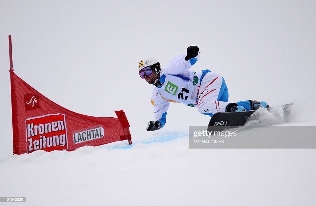 <a gi-track='captionPersonalityLinkClicked' href=/galleries/search?phrase=Andreas+Prommegger&family=editorial&specificpeople=869827 ng-click='$event.stopPropagation()'>Andreas Prommegger</a> of Austria competes during the Men's Snowboard Parallel Slalom qualification at the FIS Freestyle and Snowboarding World Ski Championships 2015 in Lachtal near Kreischberg, Austria on January 22, 2015. AFP PHOTO / MICHAL CIZEK