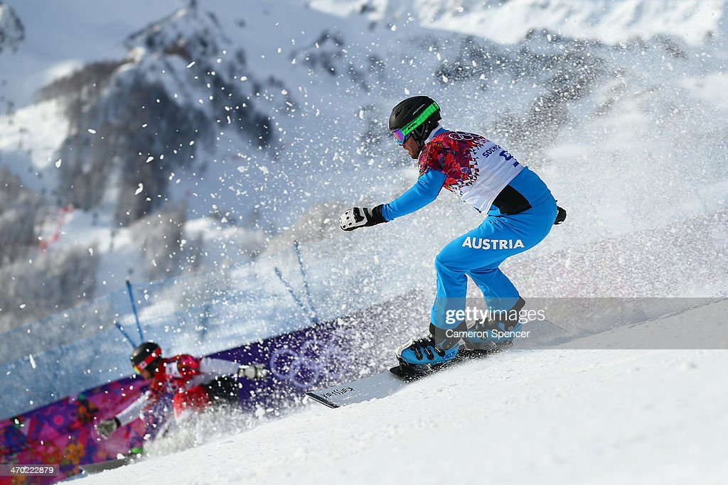 <a gi-track='captionPersonalityLinkClicked' href=/galleries/search?phrase=Andreas+Prommegger&family=editorial&specificpeople=869827 ng-click='$event.stopPropagation()'>Andreas Prommegger</a> of Austria competes in the Snowboard Men's Parallel Giant Slalom Qualification on day twelve of the 2014 Winter Olympics at Rosa Khutor Extreme Park on February 19, 2014 in Sochi, Russia.