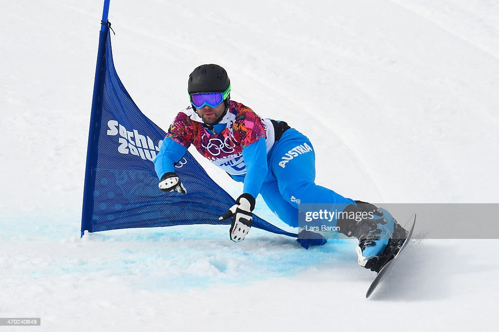 <a gi-track='captionPersonalityLinkClicked' href=/galleries/search?phrase=Andreas+Prommegger&family=editorial&specificpeople=869827 ng-click='$event.stopPropagation()'>Andreas Prommegger</a> of Austria competes in the Snowboard Men's Parallel Giant Slalom 1/8 finals on day twelve of the 2014 Winter Olympics at Rosa Khutor Extreme Park on February 19, 2014 in Sochi, Russia.