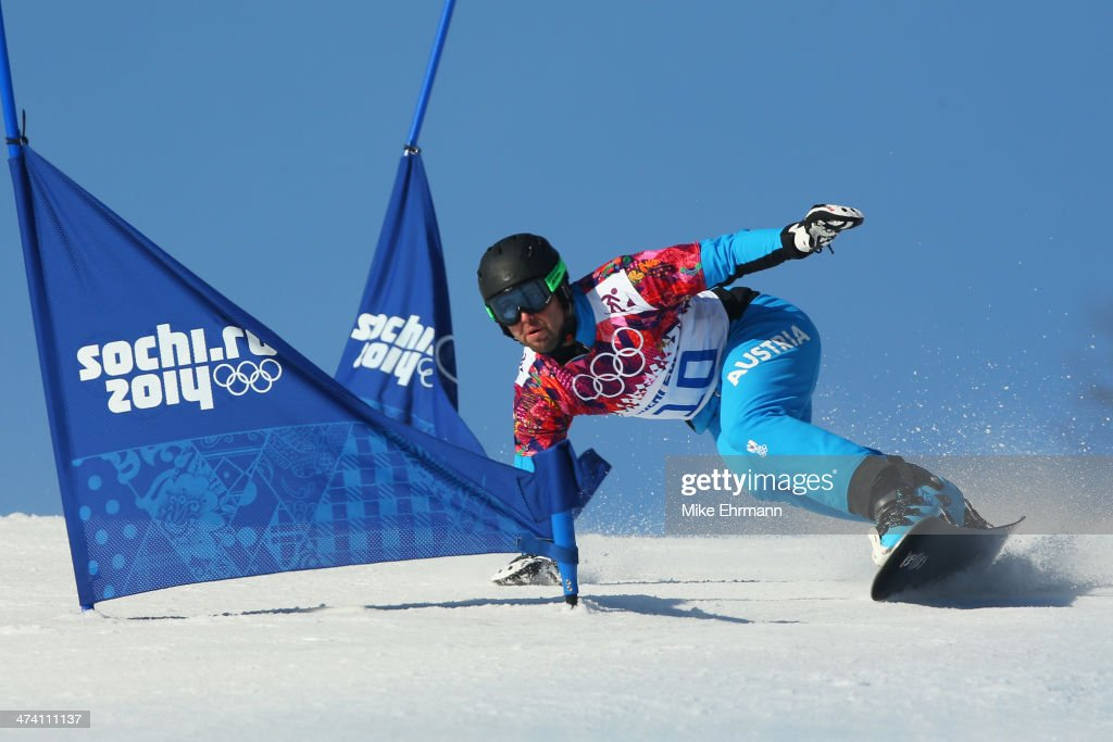 <a gi-track='captionPersonalityLinkClicked' href=/galleries/search?phrase=Andreas+Prommegger&family=editorial&specificpeople=869827 ng-click='$event.stopPropagation()'>Andreas Prommegger</a> of Austria competes in the Snowboard Men's Parallel Slalom Qualification on day 15 of the 2014 Winter Olympics at Rosa Khutor Extreme Park on February 22, 2014 in Sochi, Russia.