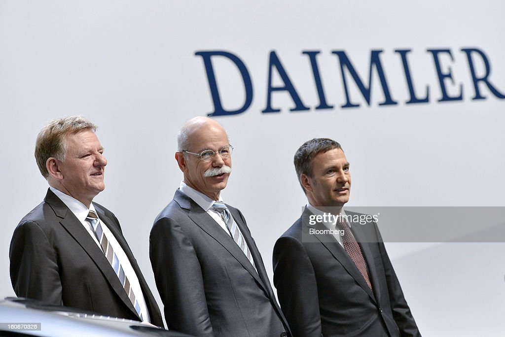 Andreas Renschler, head of Daimler AG's truck division, left, <a gi-track='captionPersonalityLinkClicked' href=/galleries/search?phrase=Dieter+Zetsche&family=editorial&specificpeople=241297 ng-click='$event.stopPropagation()'>Dieter Zetsche</a>, chief executive officer of Daimler AG, center, and Bodo Uebber, chief financial officer of Daimler AG, pose for a photograph ahead of a news conference to announce the company's results in Stuttgart, Germany, on Thursday, Feb. 7, 2013. Daimler AG, the world's third-largest maker of luxury vehicles, forecast unchanged 2013 profit as spending for new models and a revamp of the automaker's operations eat into earnings. Photographer: Guenter Schiffmann/Bloomberg via Getty Images