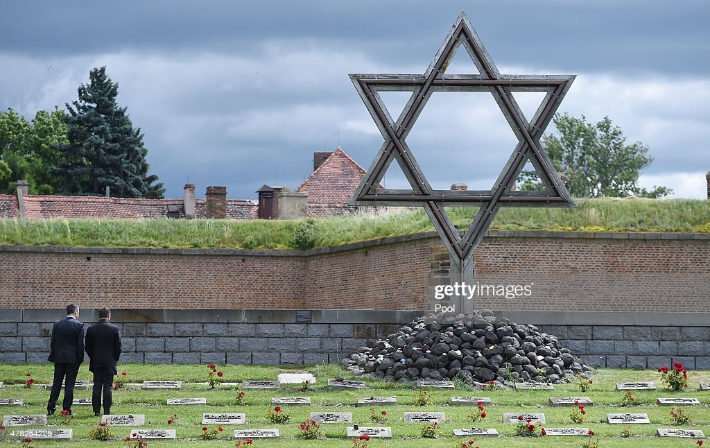 Andreas Rettig of the DFL and Hansi Flick, DFB sporting director, stand in front of the Star of David as a Delegation of the DFB visits the Terezin Concentration Camp Memorial, before the UEFA European Under 21 match between Germany and Czech Republic, on June 23, 2015 in Terezin, Czech Republic.