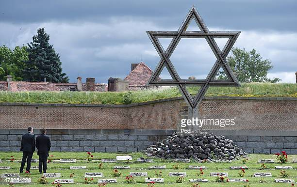 Andreas Rettig of the DFL and Hansi Flick DFB sporting director stand in front of the Star of David as a Delegation of the DFB visits the Terezin...