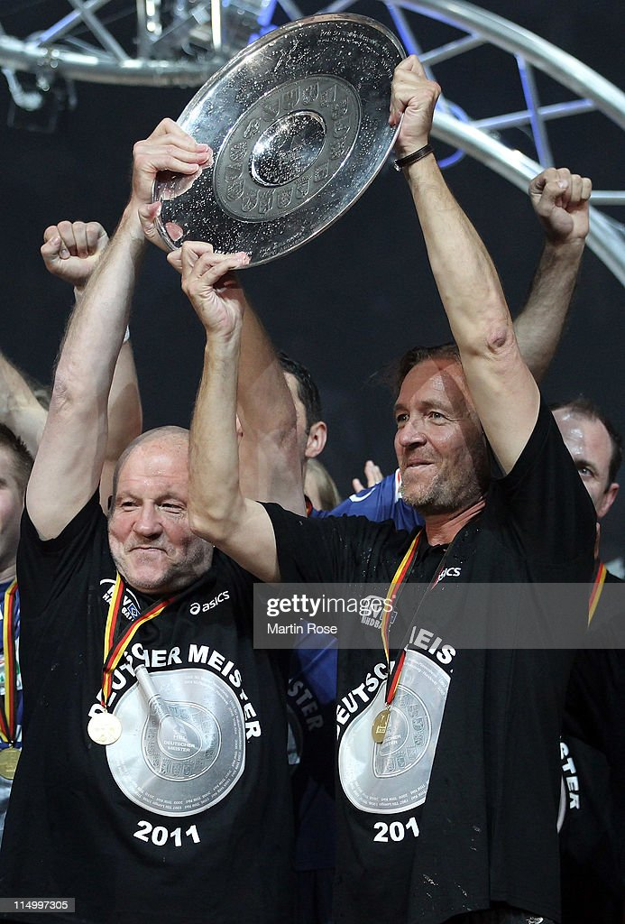 Andreas Rudolph manager of Hamburg and Martin Schwalb head coach of Hamburg celebrate with he trophy after the Toyota Handball Bundesliga match...