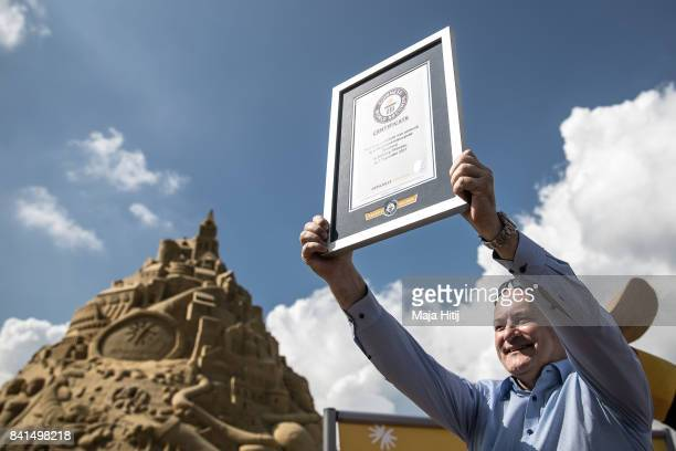 Andreas Ruettigers of a travel agency schauinslandreisen shows the certificate from the Guinness Book of World Records after setting measurement of...