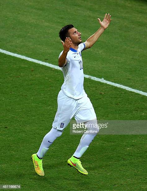 Andreas Samaris of Greece celebrates scoring his team's first goal during the 2014 FIFA World Cup Brazil Group C match between Greece and the Ivory...