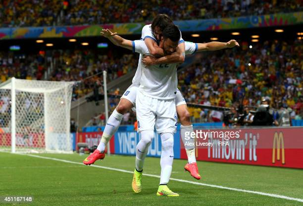 Andreas Samaris of Greece celebrates scoring his team's first goal with his teammate Giorgos Samaras during the 2014 FIFA World Cup Brazil Group C...