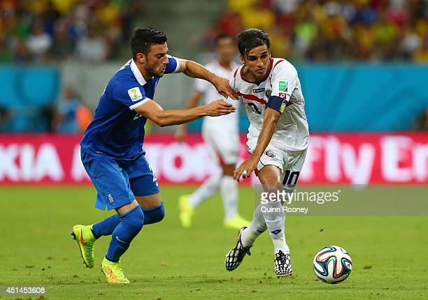 Andreas Samaris of Greece challenges Bryan Ruiz of Costa Rica during the 2014 FIFA World Cup Brazil Round of 16 match between Costa Rica and Greece...
