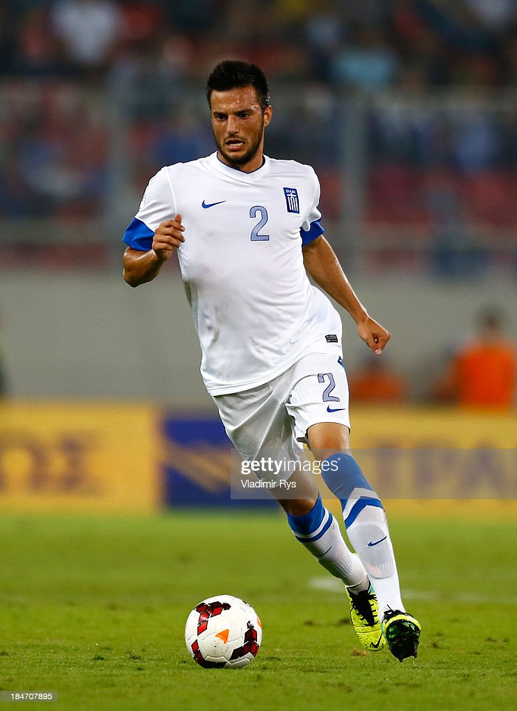 Andreas Samaris of Greece in action during the group G FIFA 2014 World Cup Qualifier match between Greece and Liechtenstein at Karaiskakis Stadium on October 15, 2013 in Athens, Greece.