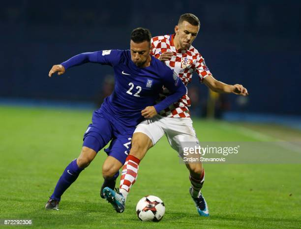 Andreas Samaris of Greece is challenged by Ivan Perisic of Croatia during the FIFA 2018 World Cup Qualifier PlayOff First Leg between Croatia and...