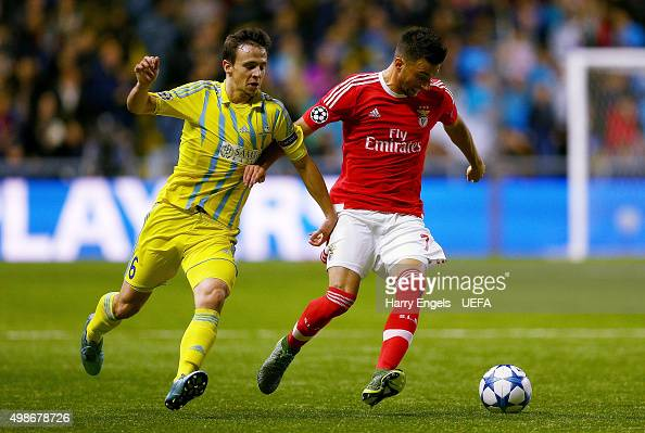 Andreas Samaris of SL Benfica is tackled by Nemanja Maksimovic of FC Astana during the UEFA Champions League match between FC Astana and SL Benfica...