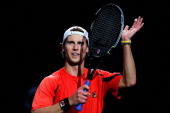 Andreas Seppi of Italy celebrates victory against Martin Klizan of Slovakia during day 1 of the BNP Paribas Masters at Palais Omnisports de Bercy on...