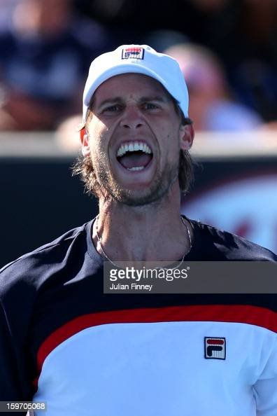 Andreas Seppi of Italy celebrates winning a point in his third round match against Marin Cilic of Croatia during day six of the 2013 Australian Open...