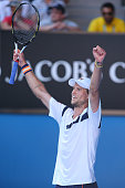 Andreas Seppi of Italy celebrates winning his third round match against Roger Federer of Switzerland during day five of the 2015 Australian Open at...