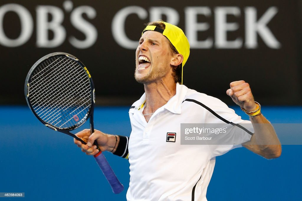 Andreas Seppi of Italy celebrates winning in his first round match against Lleyton Hewitt of Australia during day two of the 2014 Australian Open at Melbourne Park on January 14, 2014 in Melbourne, Australia.