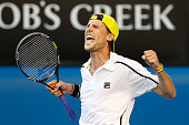 Andreas Seppi of Italy celebrates winning in his first round match against Lleyton Hewitt of Australia during day two of the 2014 Australian Open at...