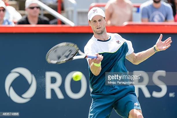 Andreas Seppi of Italy hits a return against Gilles Simon of France during day one of the Rogers Cup at Uniprix Stadium on August 10 2015 in Montreal...