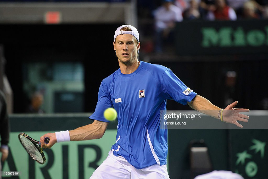 <a gi-track='captionPersonalityLinkClicked' href=/galleries/search?phrase=Andreas+Seppi&family=editorial&specificpeople=228727 ng-click='$event.stopPropagation()'>Andreas Seppi</a> of Italy hits a return to Milos Raonic of Canada during their singles match on day three of the 2013 Davis Cup quarterfinals on April 7, 2013 at Doug Mitchell Thunderbird Sports Centre in Vancouver, British Columbia, Canada.