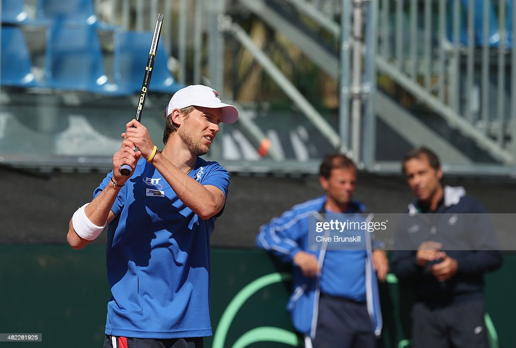 Andreas Seppi of Italy in action watched by Italian coaches during a practice session prior to the Davis Cup World Group Quarter Final match between Italy and Great Britain at Tennis Club Napoli on April 3, 2014 in Naples, Italy.