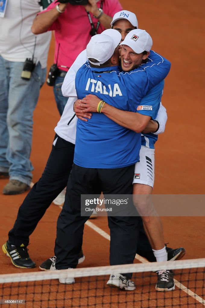 <a gi-track='captionPersonalityLinkClicked' href=/galleries/search?phrase=Andreas+Seppi&family=editorial&specificpeople=228727 ng-click='$event.stopPropagation()'>Andreas Seppi</a> of Italy is congratulated by team members after winning the fifth and decisive rubber against James Ward of Great Britain during day three of the Davis Cup World Group Quarter Final match between Italy and Great Britain at Tennis Club Napoli on April 6, 2014 in Naples, Italy.