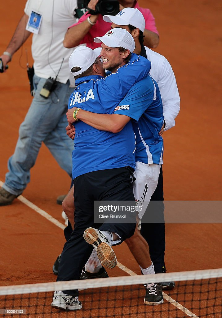 Andreas Seppi of Italy is congratulated by team members after winning the fifth and decisive rubber against James Ward of Great Britain during day three of the Davis Cup World Group Quarter Final match between Italy and Great Britain at Tennis Club Napoli on April 6, 2014 in Naples, Italy.