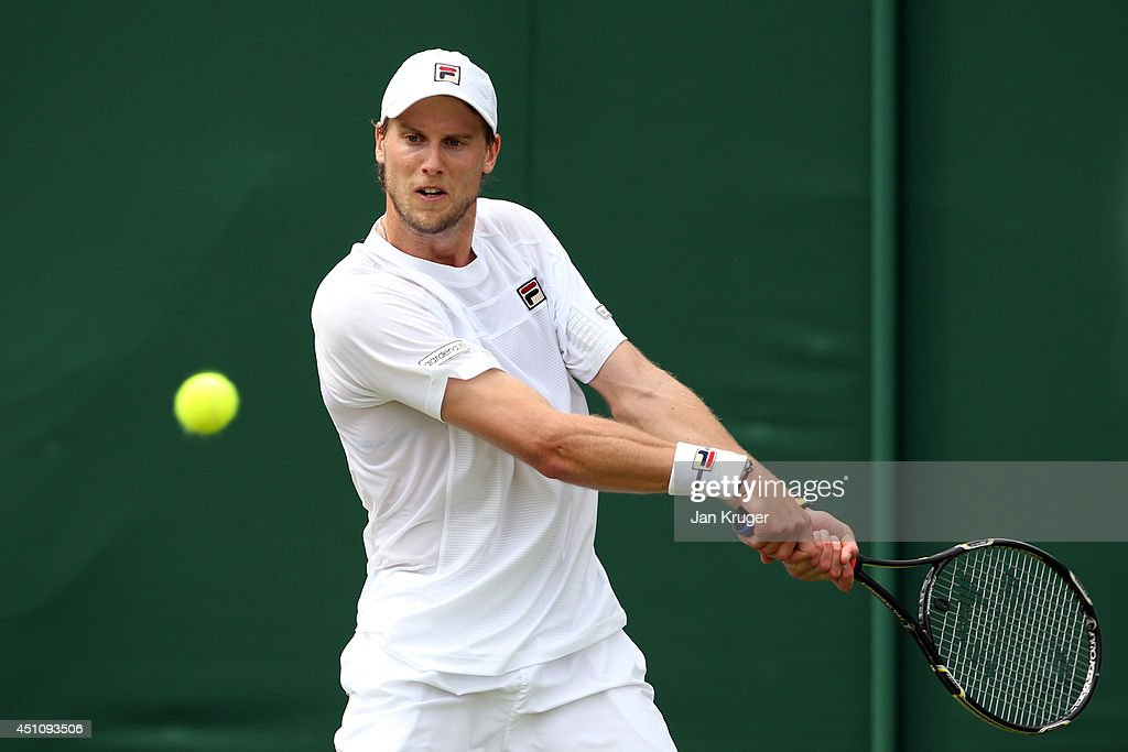<a gi-track='captionPersonalityLinkClicked' href=/galleries/search?phrase=Andreas+Seppi&family=editorial&specificpeople=228727 ng-click='$event.stopPropagation()'>Andreas Seppi</a> of Italy plays a backhand during his Gentlemen's Singles first round match against Leonardo Mayer of Argentina on day one of the Wimbledon Lawn Tennis Championships at the All England Lawn Tennis and Croquet Club at Wimbledon on June 23, 2014 in London, England.