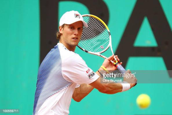 Andreas Seppi of Italy plays a backhand during the men's singles first round match between Santiago Ventura of Spain and Andreas Seppi of Italy on...