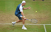 Andreas Seppi of Italy plays a backhand in his match against Gael Monfils of France during day five of the Gerry Weber Open at Gerry Weber Stadium on...